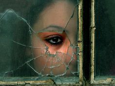 Girl's Eye In Window